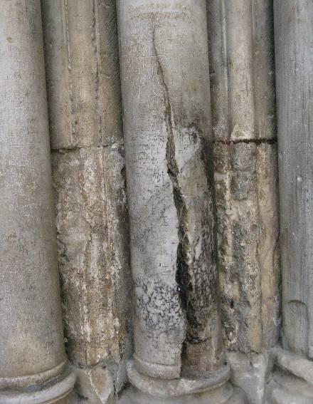 The crack in the column of  the Sacred Gate of Church of the Holy Sepulchre in Jerusalem